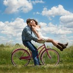 Man and woman in love on a bicycle