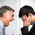 Angry boss shouting to an employee