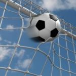 soccer ball hitting the net